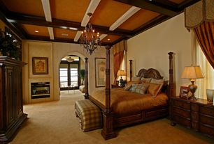 Traditional Master Bedroom with Built-in bookshelf, Chandelier, Exposed beam, Box ceiling, Carpet