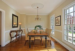 Traditional Dining Room with Chair rail, Chandelier, Crown molding, Hardwood floors