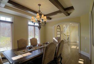 Mediterranean Dining Room with Exposed beam, Chandelier, Hardwood floors