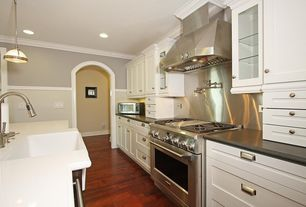 Traditional Kitchen with Pendant light, Simple granite counters, Stainless steel backsplash, Farmhouse sink, Hardwood floors