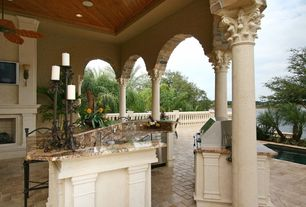 Mediterranean Porch with Fence, Pond, Outdoor kitchen, Screened porch, exterior stone floors, outdoor pizza oven, Raised beds