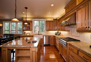 Traditional Kitchen with Built-in bookshelf, Glass panel, Farmhouse sink, Simple granite counters, Breakfast bar, Stone Tile