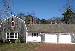 Country Garage with Concrete floors, specialty door
