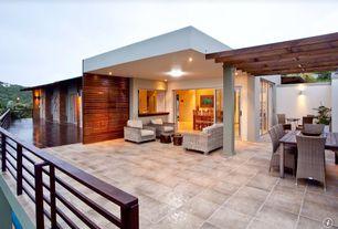 Contemporary Patio with exterior tile floors, Trellis, French doors, double-hung window, exterior concrete tile floors