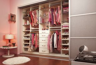 Contemporary Closet with Hardwood floors, Ikea kvikne wardrobe with sliding doors, Ikea adum high pile rug, High ceiling