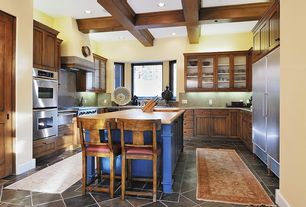 Craftsman Kitchen with U-shaped, Exposed beam, Simple Granite, Wood counters, Kitchen island, Glass panel, High ceiling