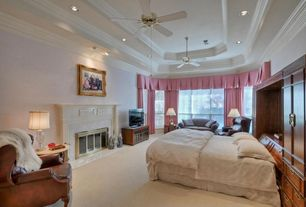 Traditional Master Bedroom with Ceiling fan, Fireplace, stone fireplace, can lights, Crown molding, double-hung window