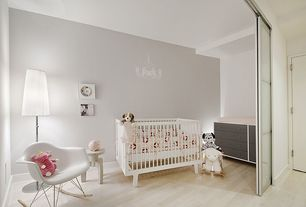 Contemporary Kids Bedroom with Hardwood floors, Standard height, flat door, Built-in bookshelf