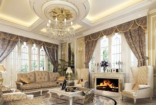 Traditional Living Room with Chandelier, can lights, Arched window, picture window, Cement fireplace, Standard height