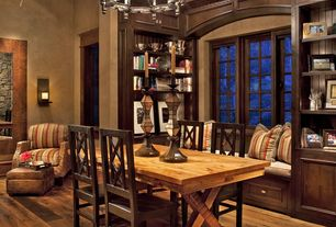 Traditional Dining Room with Built-in bookshelf, Hardwood floors, Window seat, Casement, Wall sconce, Chandelier
