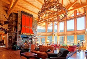 Rustic Living Room with picture window, Built-in bookshelf, Sunken living room, metal fireplace, High ceiling, Fireplace
