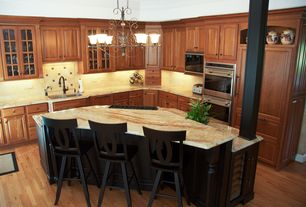 Traditional Kitchen with Breakfast bar, Black kitchen cabinets, Columns, Kitchen island, Glass panel, Onyx counters, L-shaped