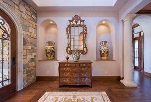 Mediterranean Entryway with High ceiling, Hardwood floors, Columns, Glass panel door