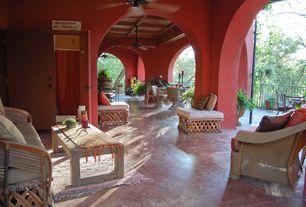 Rustic Porch with Wrap around porch, exterior concrete tile floors, Fence, Deck Railing, exterior tile floors, six panel door
