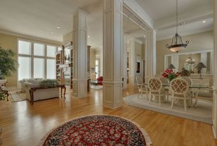 Traditional Great Room with Pendant light, Columns, Hardwood floors, Standard height, can lights, Crown molding