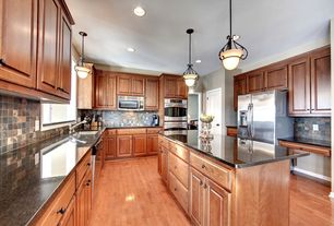 Traditional Kitchen with Stone Tile, built-in microwave, Hardwood floors, Built In Refrigerator, full backsplash, dishwasher