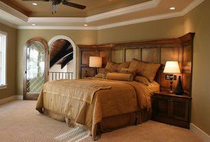 Mediterranean Master Bedroom with Casement, High ceiling, Carpet, Crown molding, specialty door, Ceiling fan, can lights