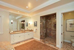 Traditional Master Bathroom with limestone tile floors, Undermount sink, Crown molding, frameless showerdoor, Raised panel