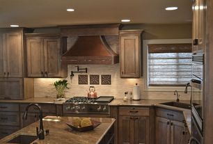 Eclectic Kitchen with L-shaped, Undermount sink, Simple granite counters, Corian counters, Kitchen island, Custom hood