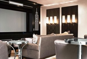 Art Deco Home Theater with Carpet, Crown molding, Wall sconce, Side table