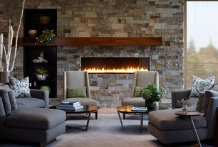 Contemporary Living Room with stone fireplace, High ceiling, Carpet, Built-in bookshelf, Balcony