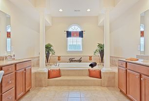 Traditional Master Bathroom with Arched window, Bathtub, Framed Partial Panel, Simple Granite, Columns, stone tile floors