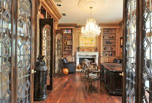 Traditional Home Office with Chandelier, Crown molding, Built-in bookshelf, French doors, Hardwood floors