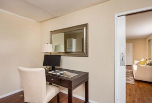 Traditional Home Office with specialty door, Standard height, Hardwood floors