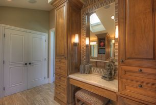 Traditional Master Bathroom with Wall sconce, Arizona tile, JERUSALEM GOLD, Limestone, Ceramic Tile, specialty door, Skylight