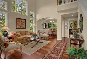 Traditional Living Room with picture window, Balcony, High ceiling, Hardwood floors, Columns