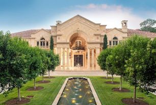 Mediterranean Exterior of Home with Arched window, Pathway, Transom window, Glass panel door, Stone exterior, Fountain
