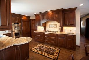 Traditional Kitchen with Framed Partial Panel, Limestone Tile, Stone Tile, Standard height, electric cooktop, full backsplash