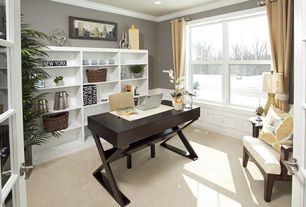 Traditional Home Office with Crown molding, Built-in bookshelf, Wainscotting, Carpet, French doors