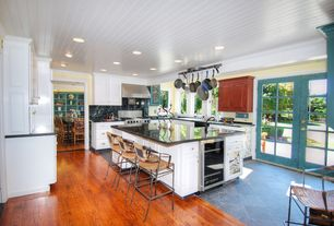 Traditional Kitchen with Crown molding, French doors, Hand scraped maple amber, click lock hardwood flooring, Hardwood floors