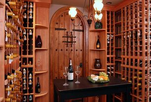 "Mediterranean Wine Cellar with Chandelier, Crown molding, 8'0"" Tall Rustic Knotty Alder Arched Prehung Wood Door Unit #UK20"