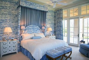Traditional Master Bedroom with Crown molding, Ceiling fan, interior wallpaper, Transom window, French doors, Carpet