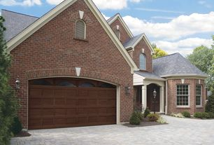 Traditional Garage with specialty door, Brick exterior, specialty window, Concrete floors, Standard height