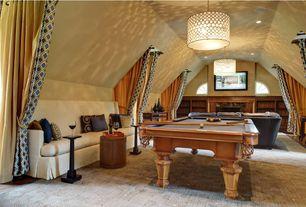 Mediterranean Game Room with Pendant light, can lights, specialty window, Built-in bookshelf, Hardwood floors