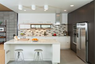 Contemporary Kitchen with Kitchen island, Breakfast bar, Subway Tile, travertine tile floors, flush light, Corian counters
