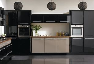 Contemporary Kitchen with Flush, Vinyl floors, Wood counters, Inset cabinets, Pendant light, European Cabinets, L-shaped
