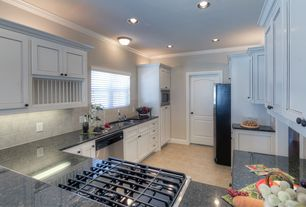 Traditional Kitchen with Simple granite counters, Limestone Tile, dishwasher, Built In Refrigerator, Flat panel cabinets
