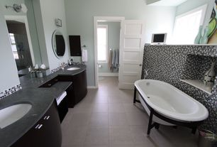 Contemporary Master Bathroom with Vinyl floors, Stone Tile, Quartz counters, Frameless, frameless showerdoor, Undermount sink