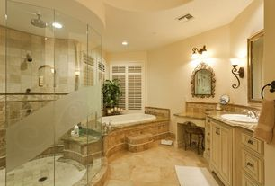 Traditional Full Bathroom with Standard height, Casement, stone tile floors, Rain shower, Raised panel, drop in bathtub