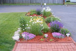 Traditional Landscape/Yard with exterior stone floors, Raised beds, Fence, exterior brick floors, Pathway
