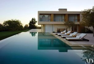 Modern Swimming Pool with French doors, Christian liagre estran chaise lounge, Infinity pool, Fence