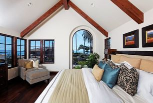 Craftsman Master Bedroom with Hardwood floors, Cathedral ceiling, Exposed beam