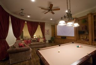 Traditional Game Room with can lights, Crown molding, Pendant light, Built-in bookshelf, Ceiling fan, Hardwood floors