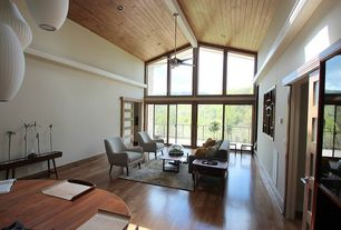 Contemporary Great Room with can lights, Ceiling fan, Exposed beam, picture window, Pendant light, Hardwood floors