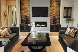 Contemporary Living Room with Built-in bookshelf, Fireplace, specialty door, travertine tile floors, Paint, can lights