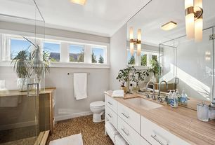 Contemporary Full Bathroom with Travertine counters, Saber Sconce, Crown molding, Pental Saturnia Polished Travertine, Flush